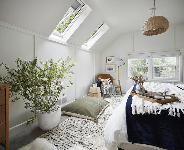 attic bedroom with two fresh air skylights with shades or blinds open for  ventilation more cost effective than a dormer
