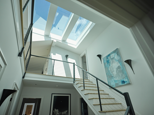 Three VELUX Skylights at the top of the staircase allows daylight pours into other
